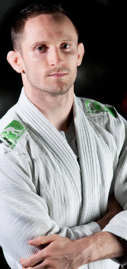 Timothy Hart in white Gi with green markings on shoulder